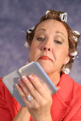 Older Woman is Applying Makeup