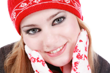 Image of woman wearing tuque and gloves