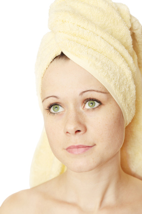 Beautiful Women with a towel over her head